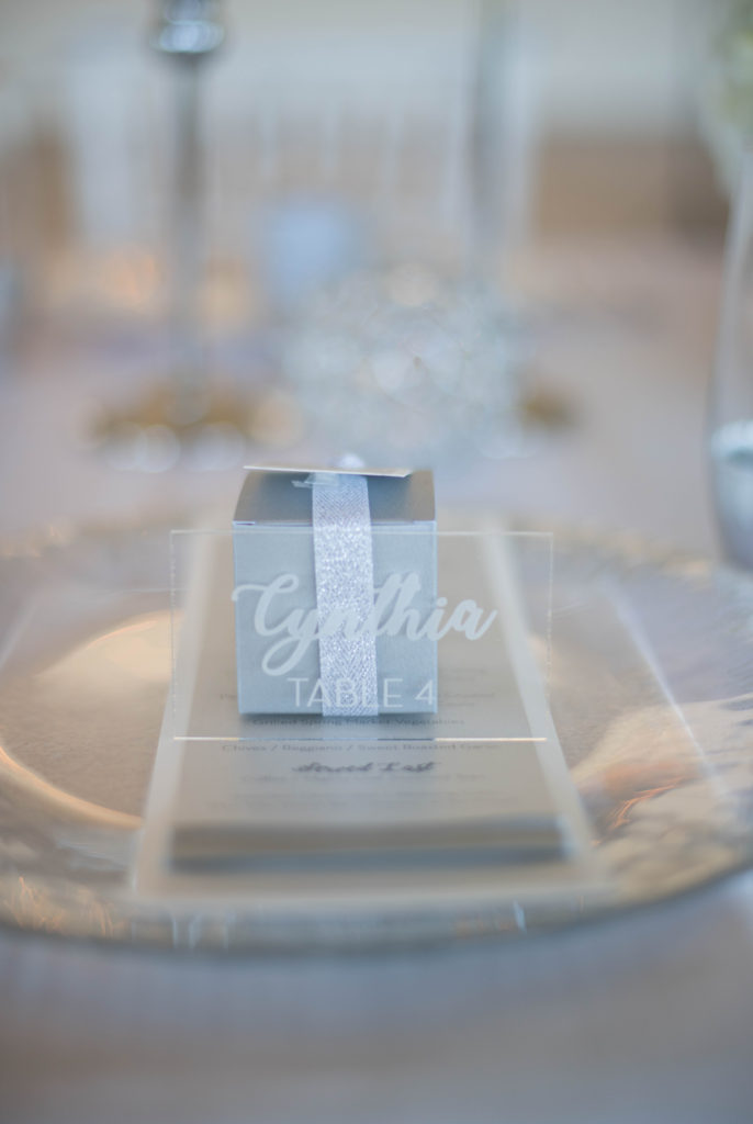 plexiglass table number, silver favor box, wedding place setting