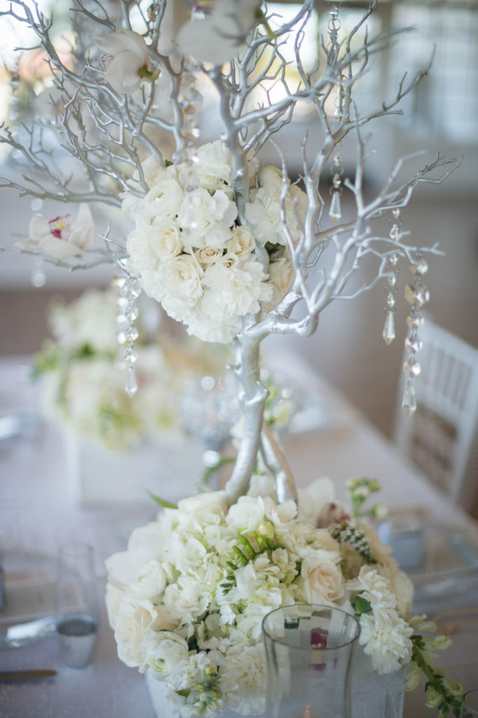 white centerpiece, orchids, hydrangea, silver branches, white and silver flowers