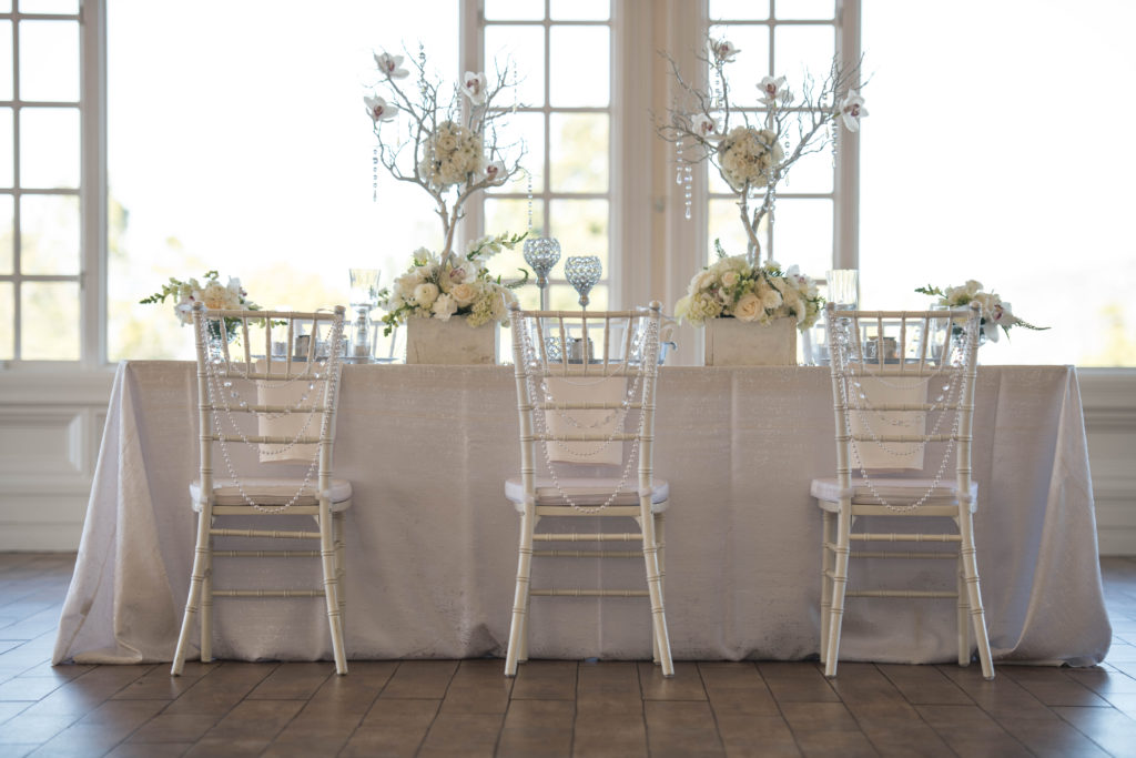 white and silver wedding, white tablescape, orchids, chiavari chairs