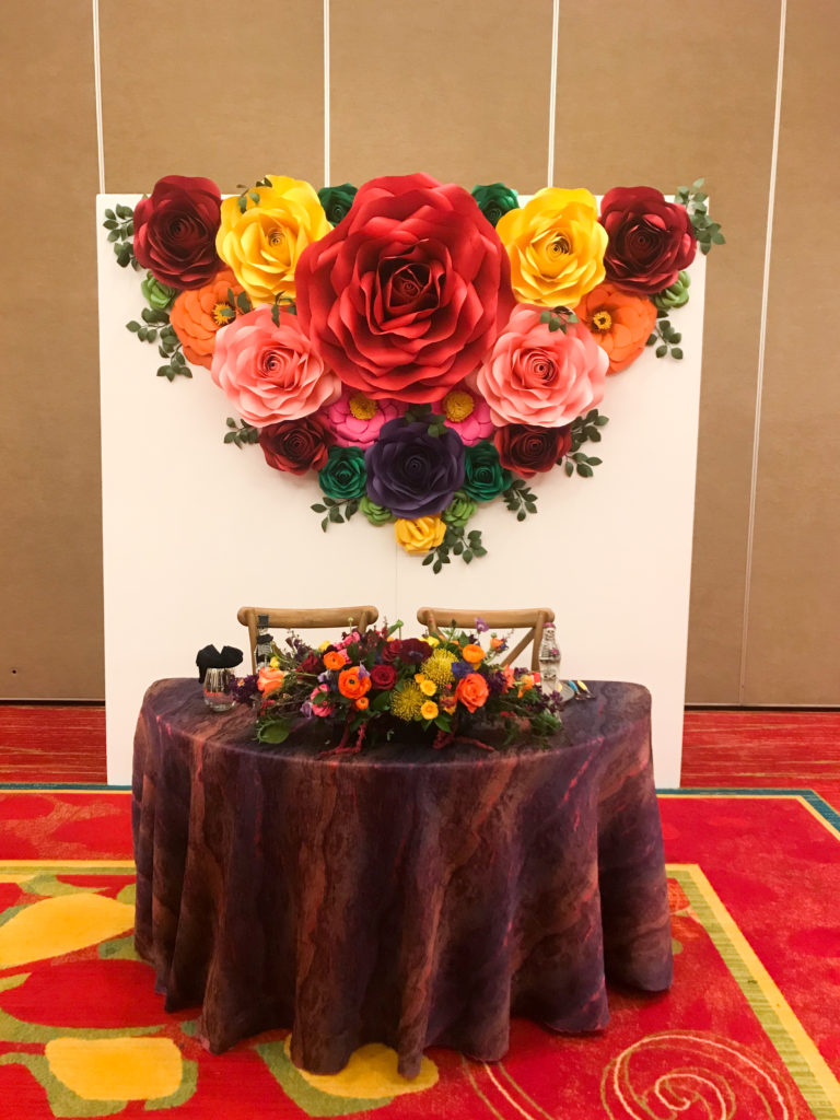 dia de los muertos sweetheart table, day of the dead wedding, flower paper wall, vibrant coloful wedding centerpiecesable,
